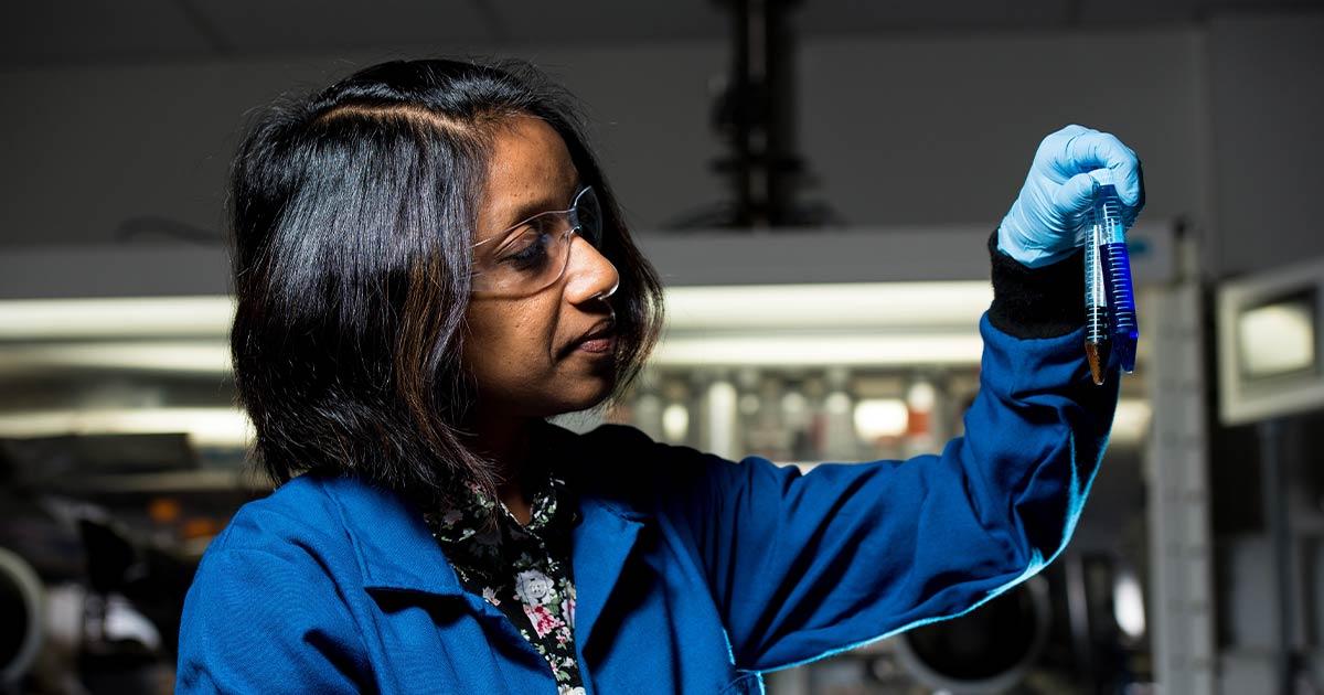 Female scientist inspecting vials of fluid