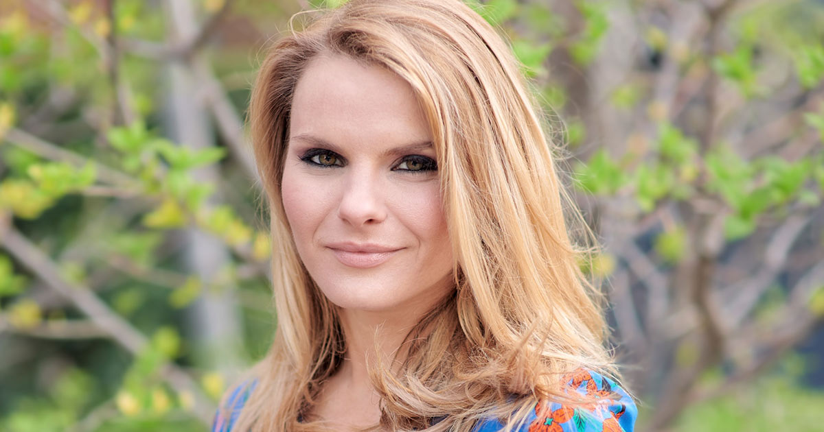 Michele Romanow smiling outdoors