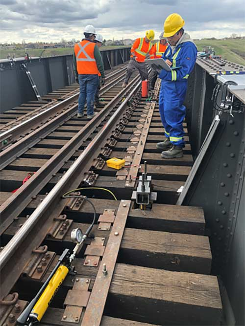 Symroc's crew installing vibration sensing system on Lethbridge High Level Bridge