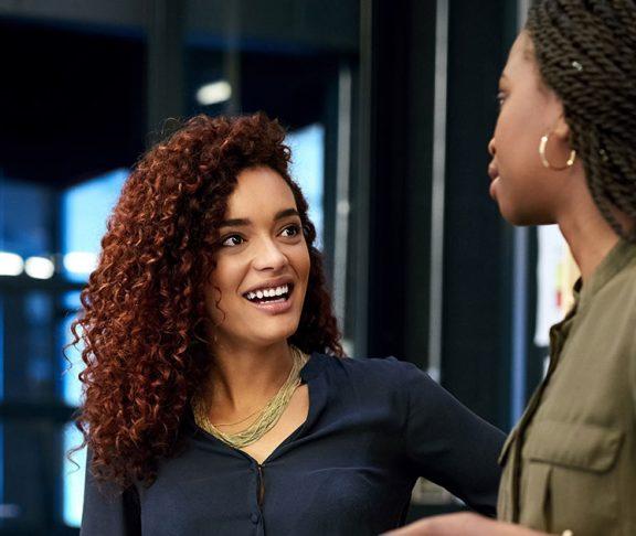 Two Black women having a business conversation