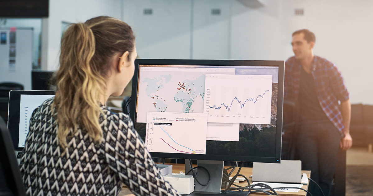 Woman analyzing different kinds of data in an office