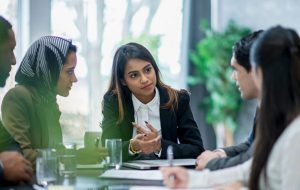 Woman leading a diverse business meeting