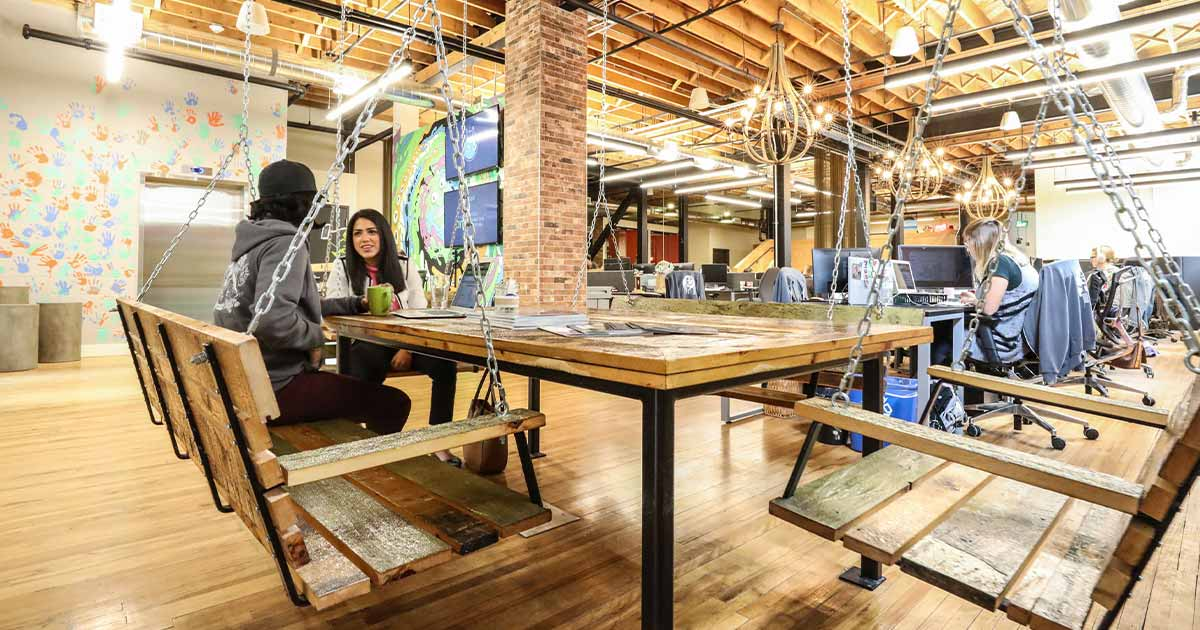 Wooden swing desk in the Vidyard headquarters