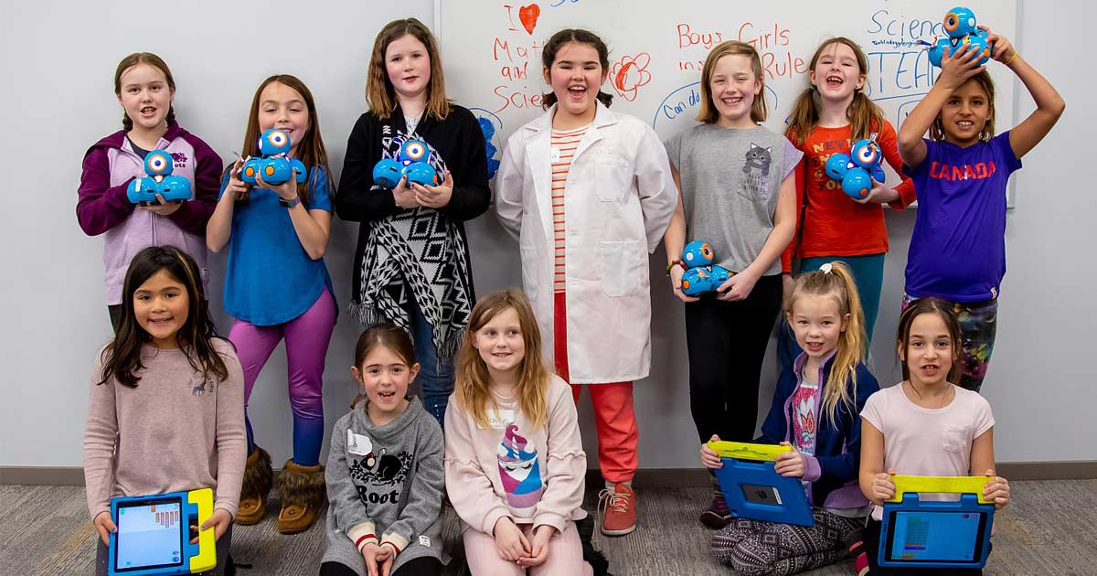 Young girls from Queen's Connections showing off their STEM projects