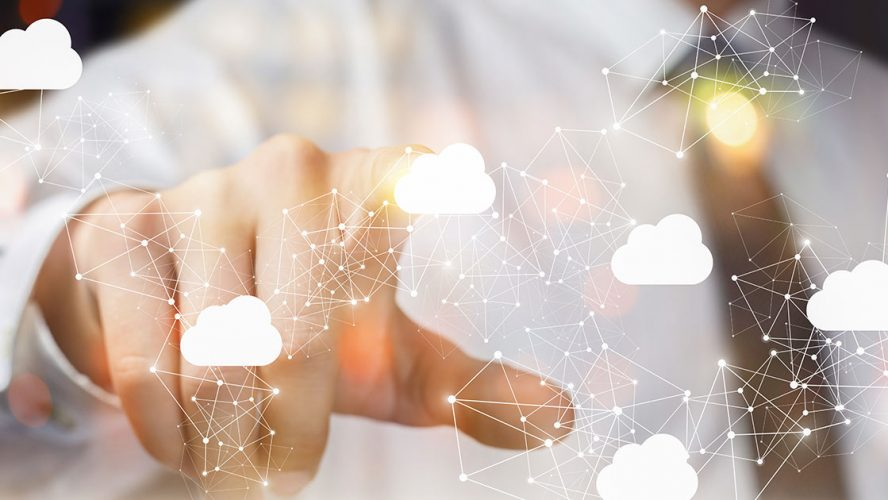 Person in suit pointing at image of a hybrid cloud