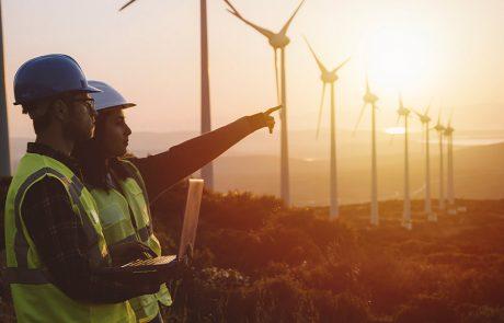 Engineers working on a wind turbine farm