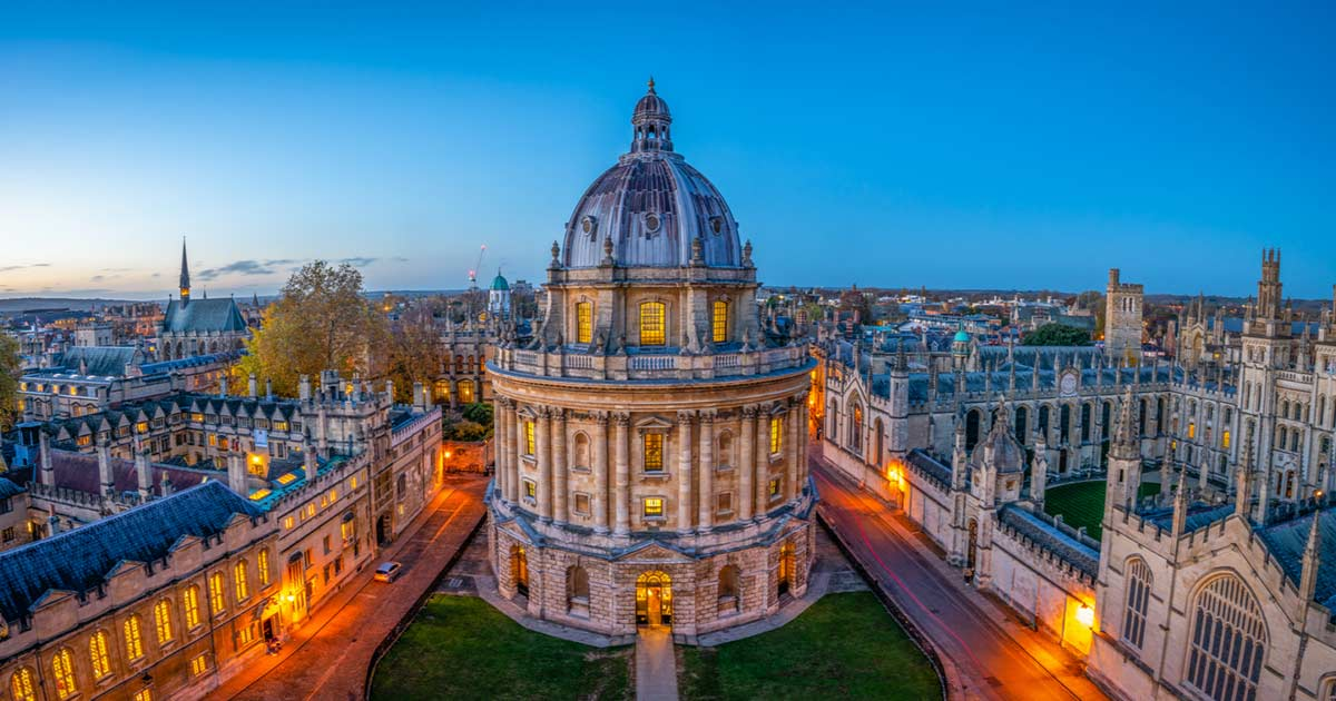 Oxford University lit up at dusk