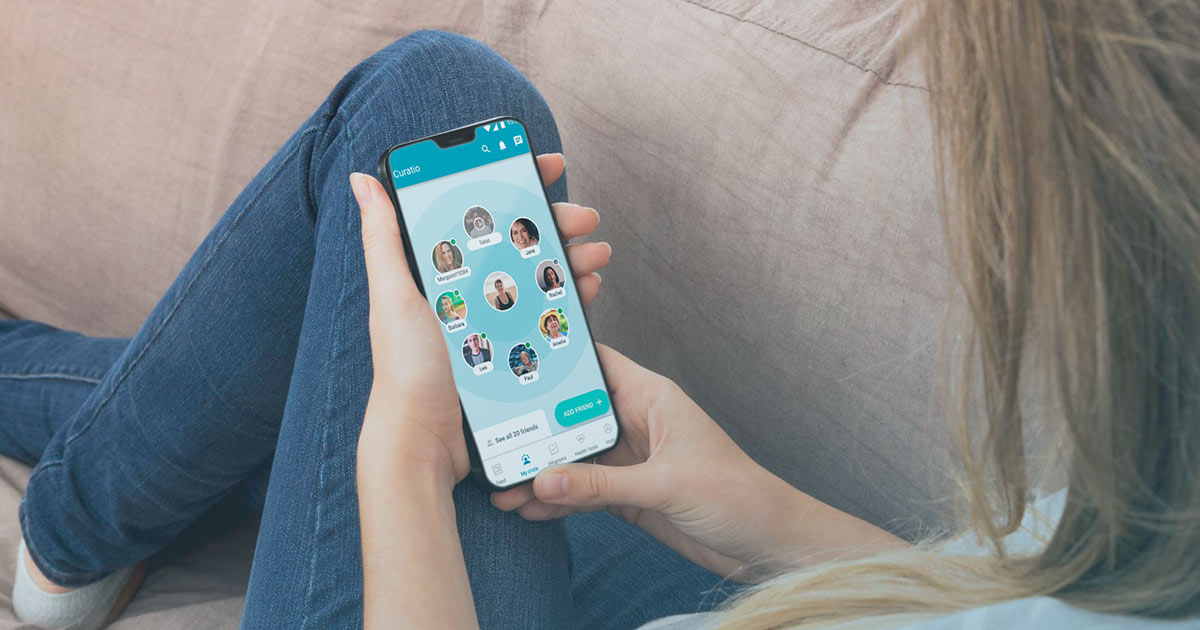 Person on couch using Curatio app on their phone