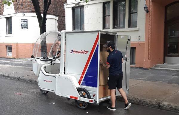Purolator's zero-emission vehicle on a delivery