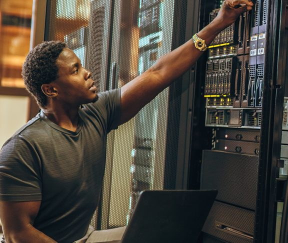 A computer technician working in the server room
