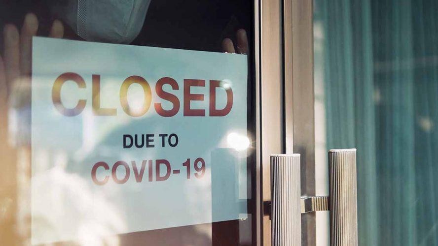 A shop showing Closed-Due-To-COVID-19 sign