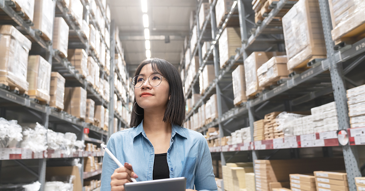 Girl tallying products in a warehouse