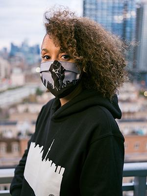 Nadia Lloyd, Painter and Fashion Designer, modelling her mask