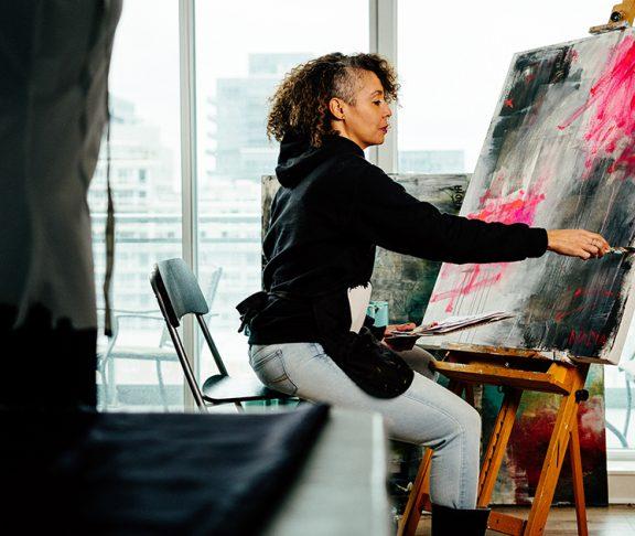 Toronto artist Nadia Lloyd working on a canvas