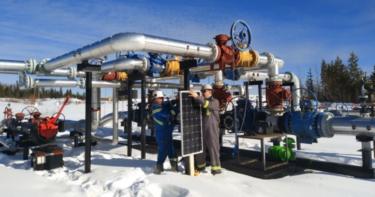 Installing the solar panel of Symroc's sensing system on an oil and gas facility