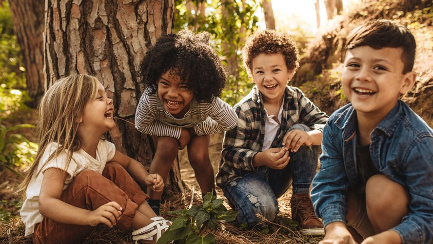 Group of cute kids playing in the forest