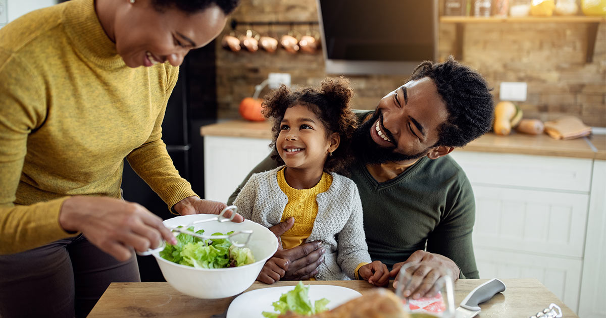 african american family smiling food