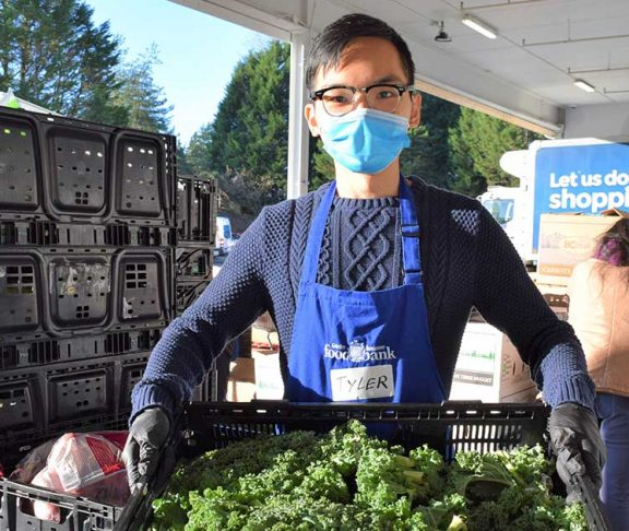 asian man food banks canada