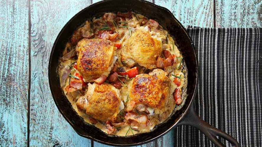 chicken frying in a pan