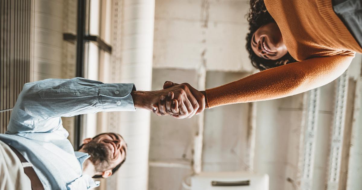 happy couple shaking hands