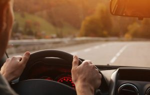 man driving road