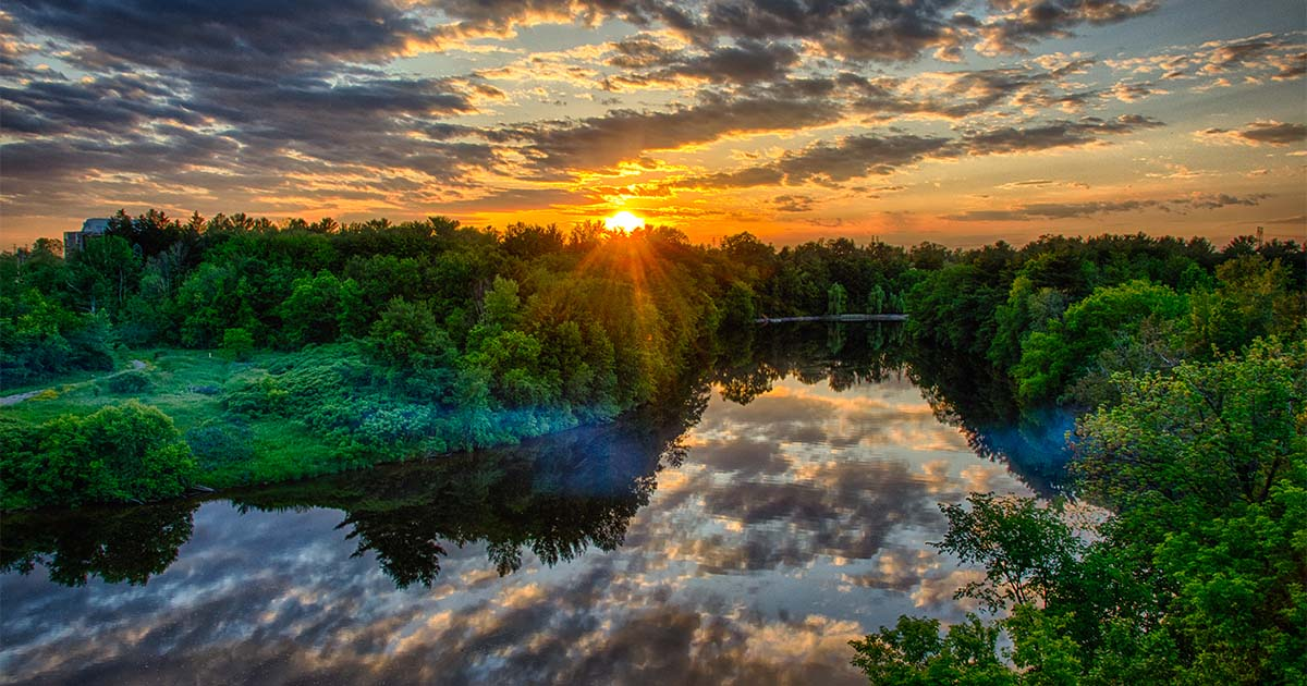 sunset over rideau river natural climate solutions