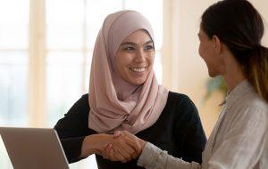 muslim woman shaking hands