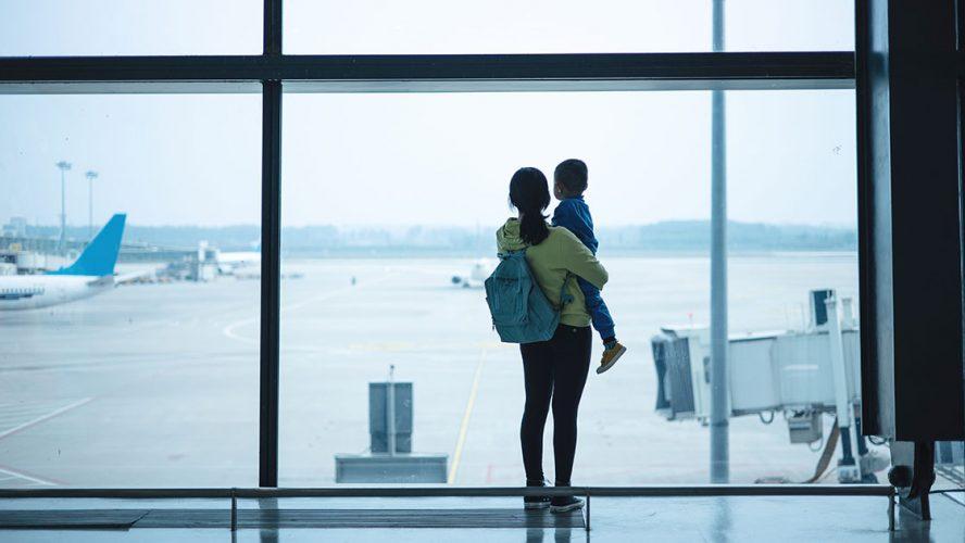 woman child airport fragomen