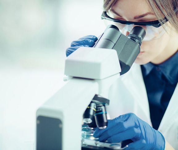 woman scientist microscope stem