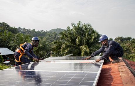 Header - Workers placing solar panel