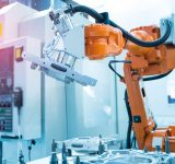 en fabriksrobotarm