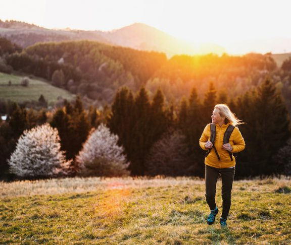 Front,View,Of,Senior,Woman,Hiker,Walking,Outdoors,In,Nature