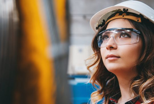 Young female engineer wearing PPE