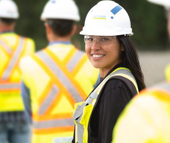 Smiling female construction worker
