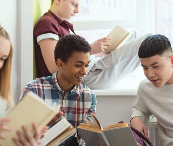High school students reading books together