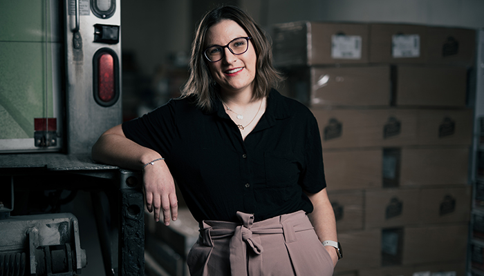 A woman posing in a college workshop