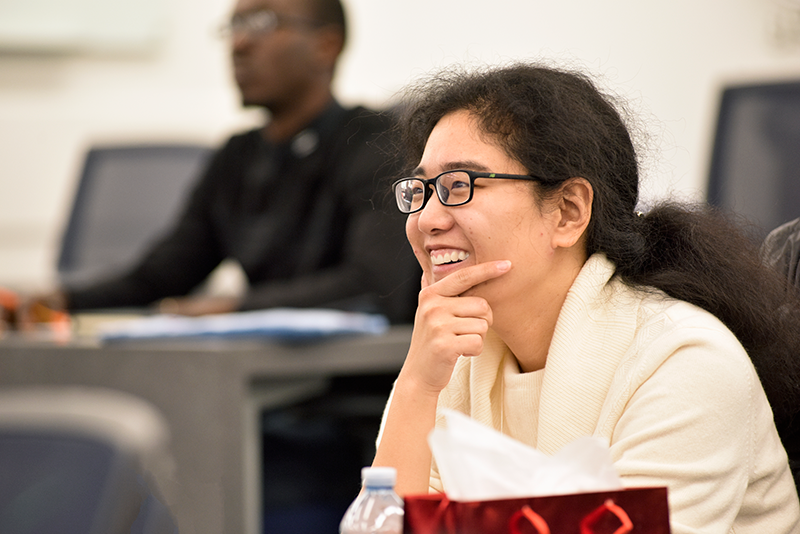 Female Student Smiling during Lecture