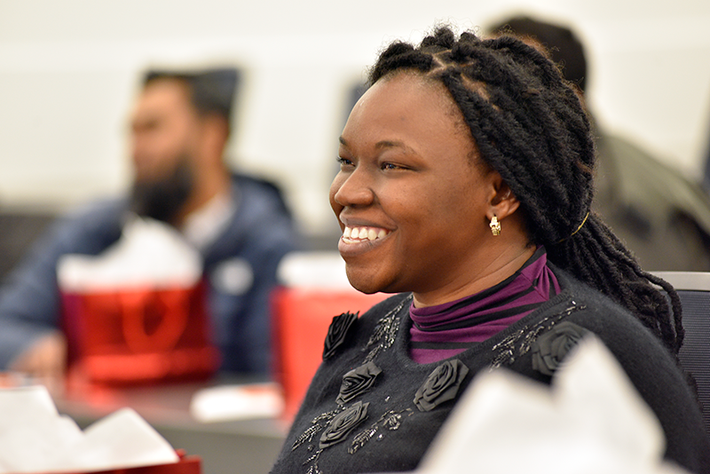 Woman at lecture smiling