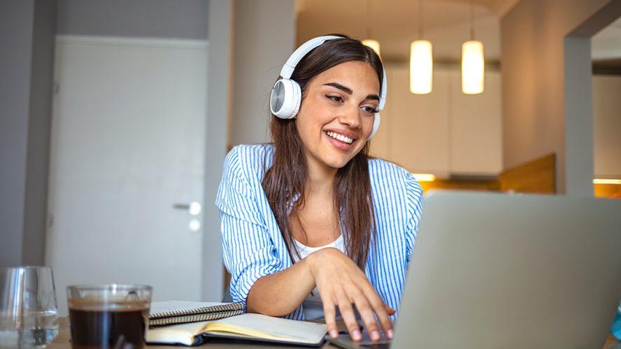 girl headphones laptop