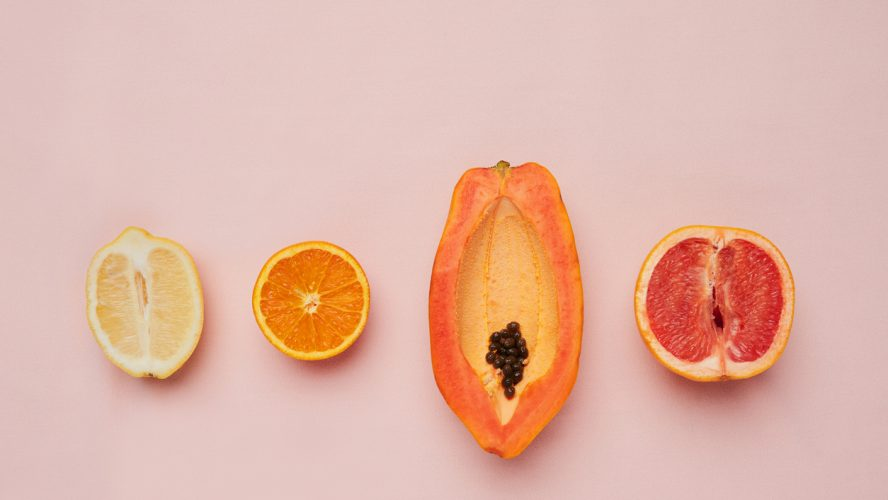 Studio shot of a row of fruit against a pink background