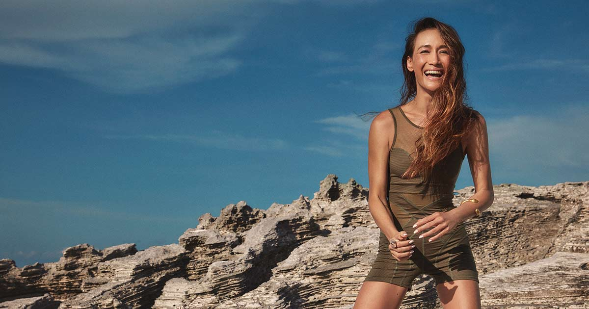 Maggie Q at the beach smiling