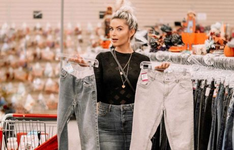 Sarah Nicole Landry shopping for pants in Value Village