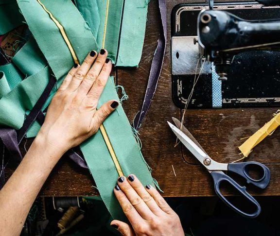 Top-down view of someone's hands sewing
