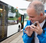 Blind-man-using-cellphone-at-bus-stop