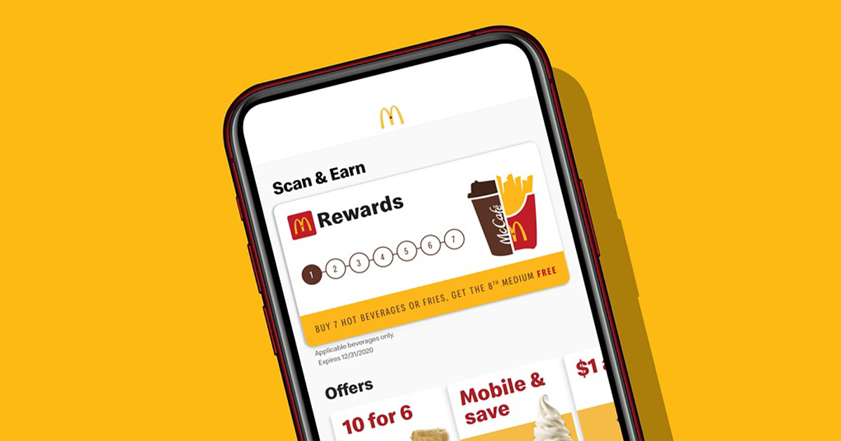 McDonald's app on a phone against a golden background