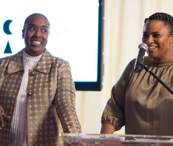 Dr. Jill Andrew and Aisha Fairclough speaking at an event