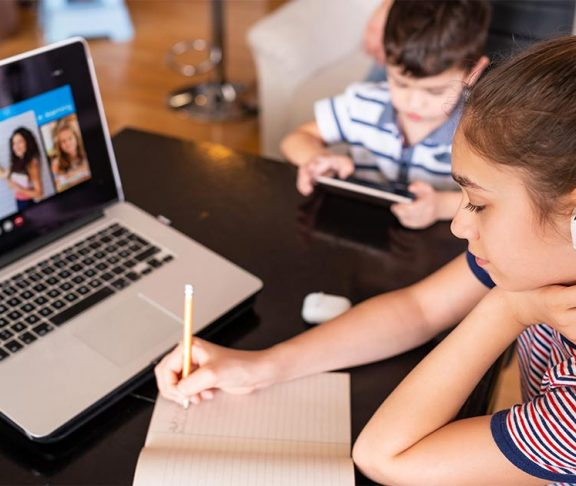 Two Kids doing Homework with eLearning