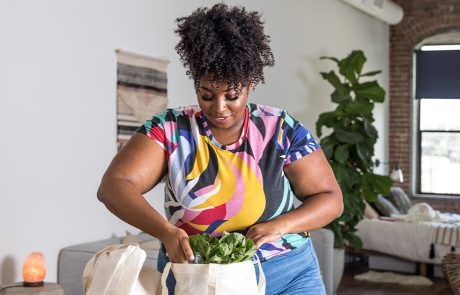 Women back at home after shopping groceries