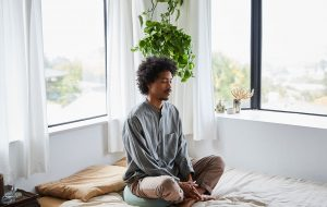 black man meditating