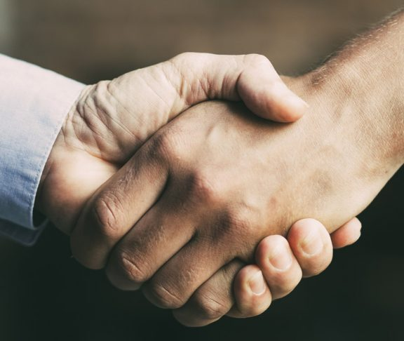 shaking hands working together